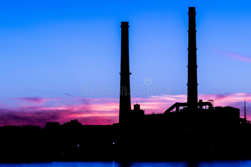 The evening thermal power station on the Neva river embankment in Saint Petersburg, Russia royalty free stock photo