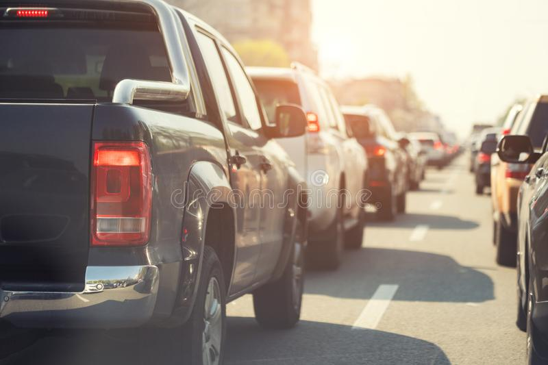 Evening traffic jam on busy city highway. Rows of car stck on road due to crush accident. Sunset metropolis rush hour scene. Street, drive, night, view royalty free stock photo