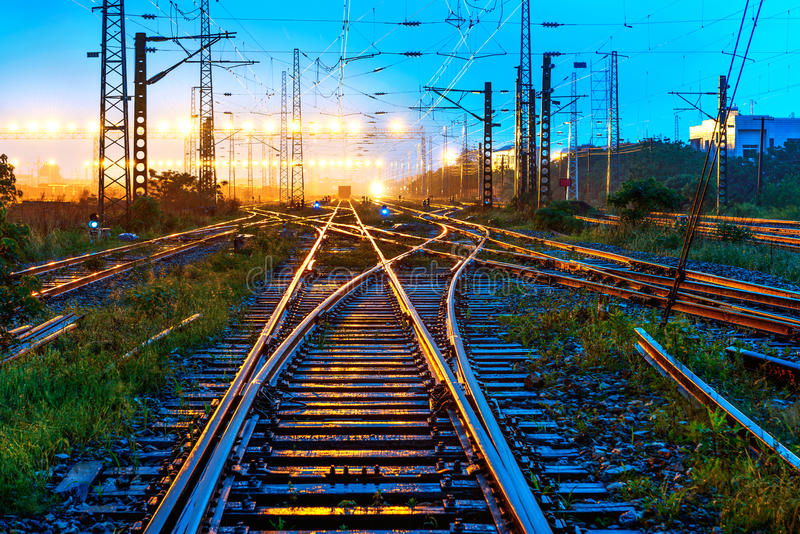 Evening trains freight yard intertwined tracks royalty free stock photos