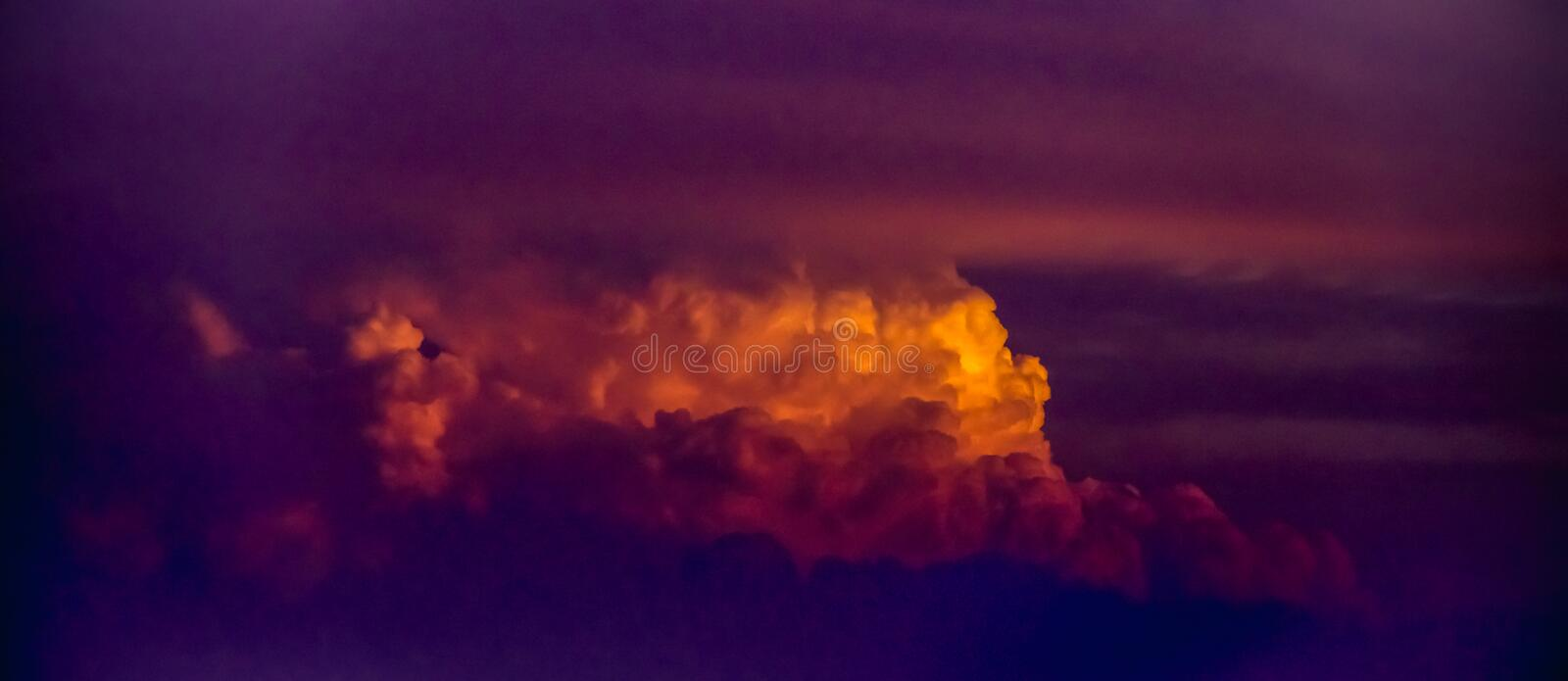 Evening twilight sky with cloud while sun setting down. Purple,pink,ultra violet and orange sunset sky backdrop. Beautiful natural. Sky abstract  background royalty free stock image