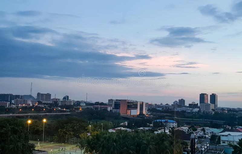 Evening view of Abuja, Nigeria's capital city; Beautiful cityscape. Sunset view of the city of Abuja, Nigeria; Clouds in the clear evening sky. beautiful stock photography