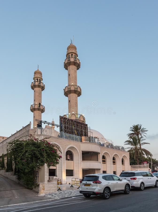 Evening view from the adjacent street to the Ahmadiyya Shaykh Mahmud mosque in Haifa city in Israel. Haifa, Israel, July 11, 2019 : Evening view from the stock photos