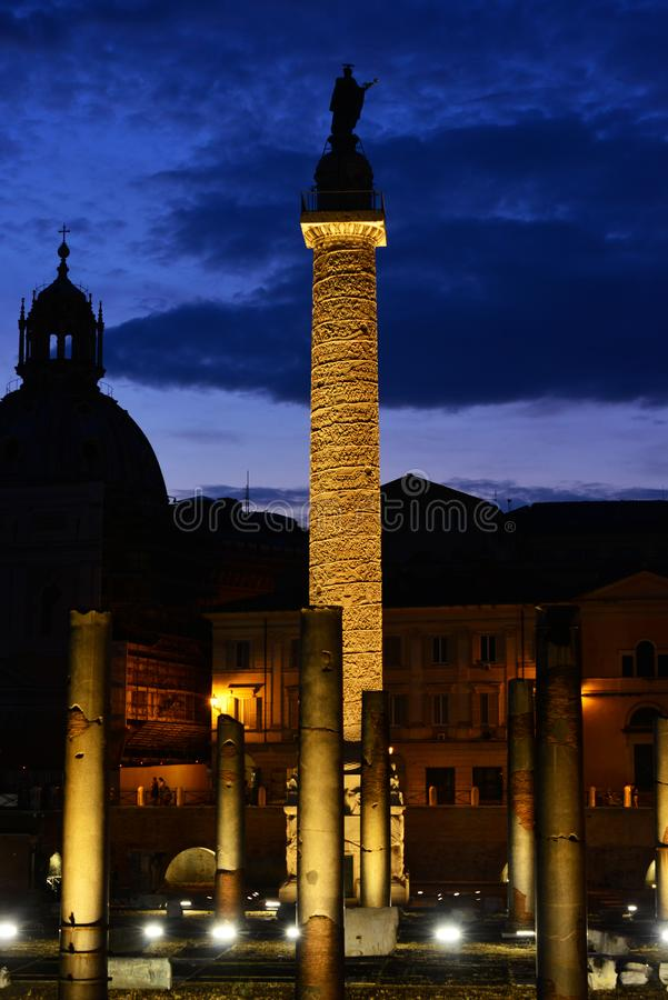 Trajan`s Column at night. Evening view of the ancient Trajan`s Column in the Imperial Forum in Rome royalty free stock photo