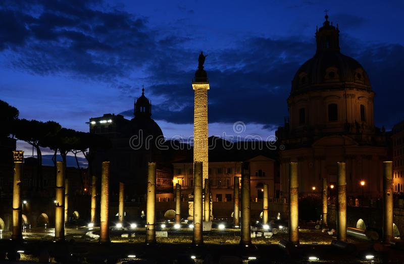 Trajan`s Column at night. Evening view of the ancient Trajan`s Column in the Imperial Forum in Rome stock photos