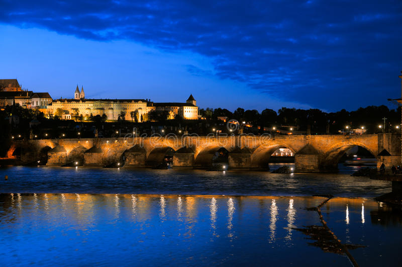 Evening view of Charles Bridge, Prague. Evening view of Charles Bridge over Vltava river from Novotneho Lavka, Prague, Czech royalty free stock photo