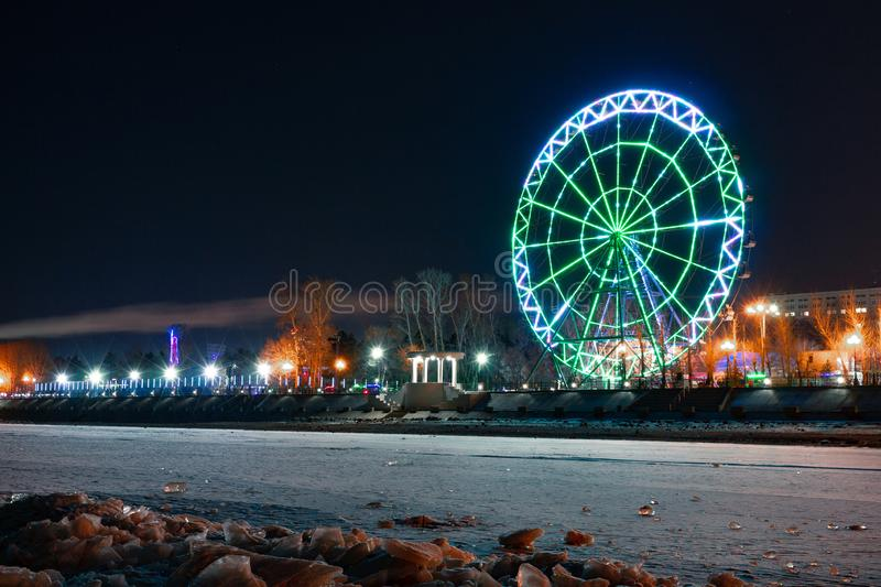 View of the city of Khabarovsk from the Amur river. Ferris wheel. royalty free stock photos