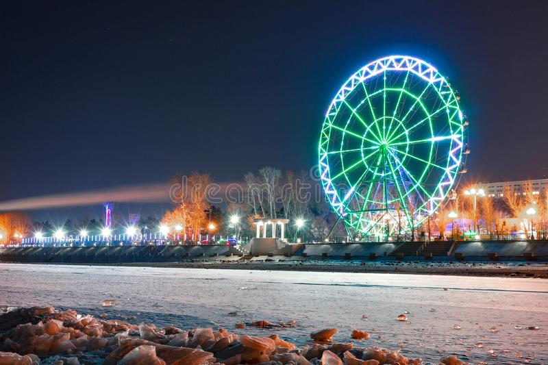 View of the city of Khabarovsk from the Amur river. Ferris wheel. royalty free stock photography