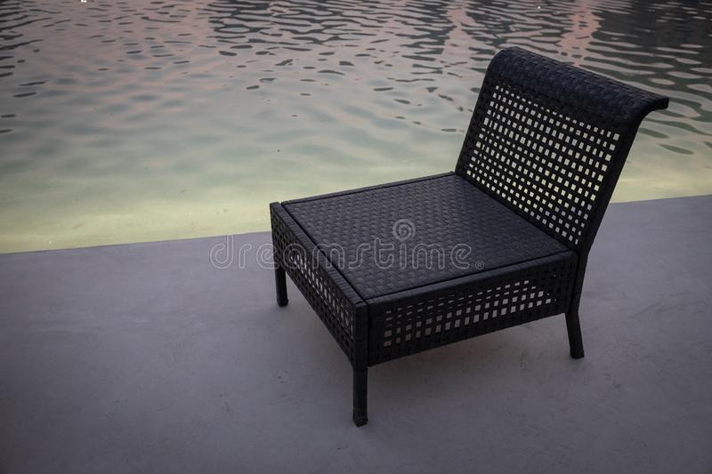 Evening view of Empty chair near water pool royalty free stock photos