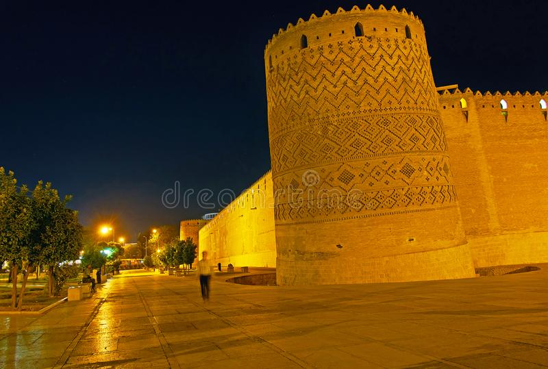 The leaning tower of Karim Khan citadel, Shiraz, Iran. The evening  view of the extant leaning tower of medieval Karim Khan citadel, decorated with carved brick stock image