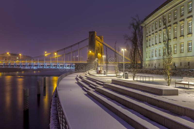 Evening view of Grunwaldzki Bridge and the boulevard at the Lower Silesian Voivodship Office - Wrocław, Poland. Evening view of Grunwaldzki Bridge and the royalty free stock images