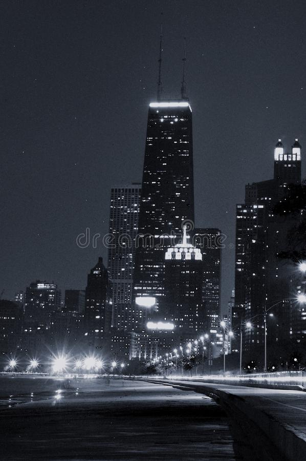 Black and white image of landmark Chicago skyline at night royalty free stock photography