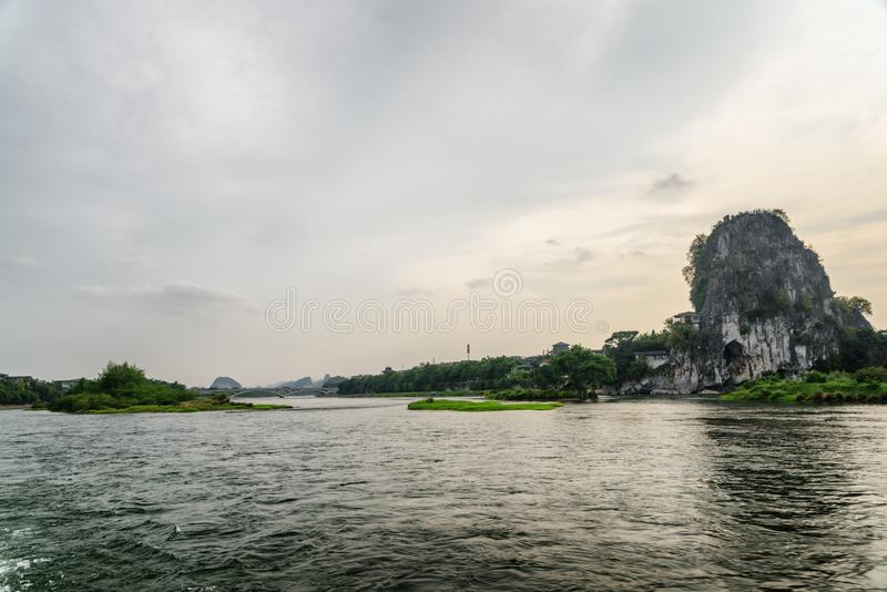 Evening view of the Li River (Lijiang River), Guilin, China. Beautiful landscape at sunset. The Fubo Hill (Wave Subduing Hill) is visible at right side. Guilin stock photo