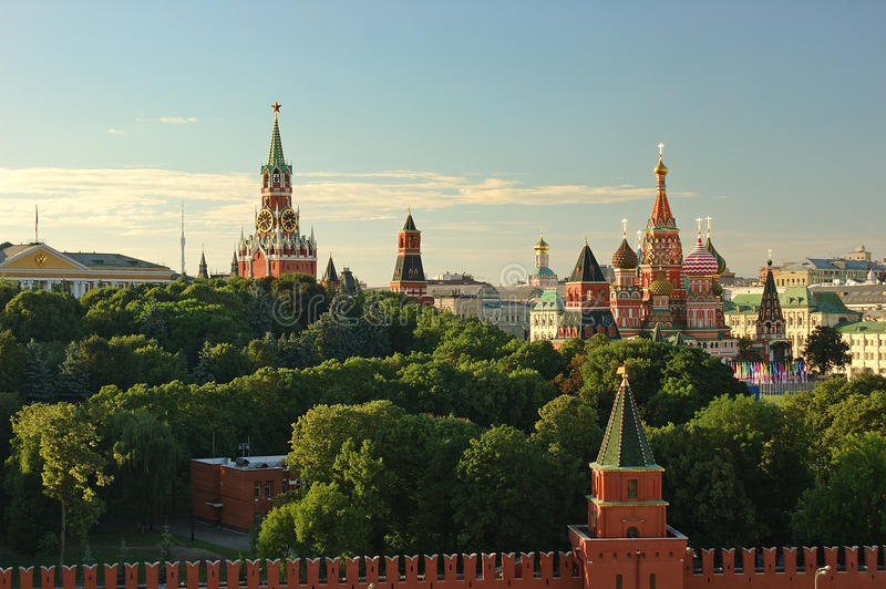 Evening view on Moscow Red Square Kremlin towers red square wall stars and Clock Kuranti Saint Basil Cathedral church. Panorama fr royalty free stock photo