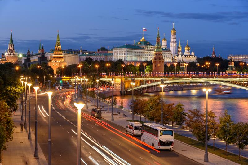 Evening view of Moscow street. Embankment of Moscow river. Traces of car headlights moving cars. stock photo