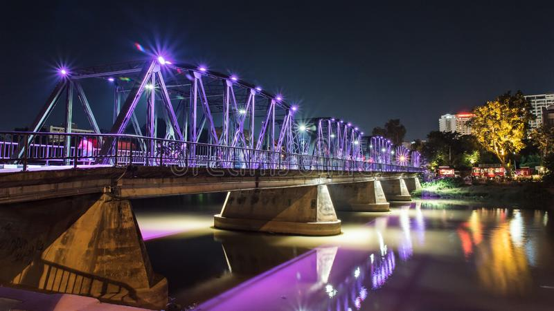Evening view of the old iron structure bridge in Chiangmai, Thailand royalty free stock images