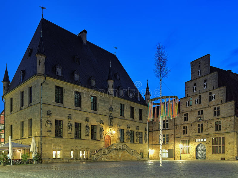 Evening view of Old Town Hall and Weigh House in Osnabruck, Germany. Osnabruck, Germany. Evening view of Market Square with Old Town Hall, Weigh House and royalty free stock images