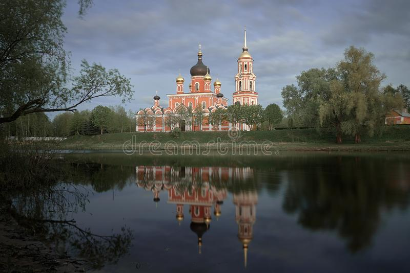 Resurrection Cathedral in Staraya Russa is reflected in the river. Spring landscape. stock photography