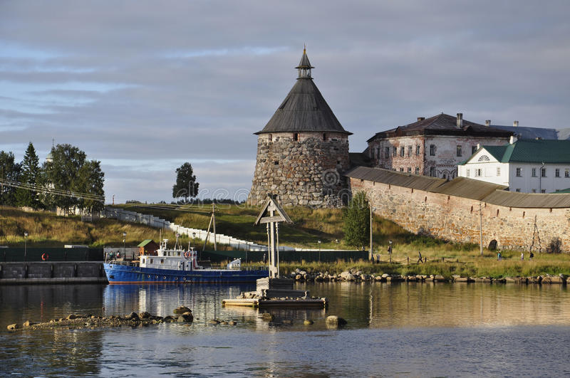 Evening view of the Solovetsky Spaso-Preobrazhensky monastery and the boat. White sea, Russia, Solovki island stock images