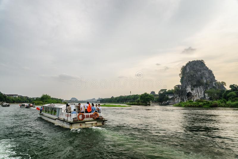 Evening view of tourist boats sailing along the Li River stock images