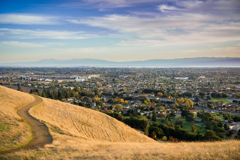 Evening view towards Fremont from Garin Dry Creek Pioneer Regional Park. South San Francisco bay and Santa Cruz mountains in the background, hiking trail in stock photography