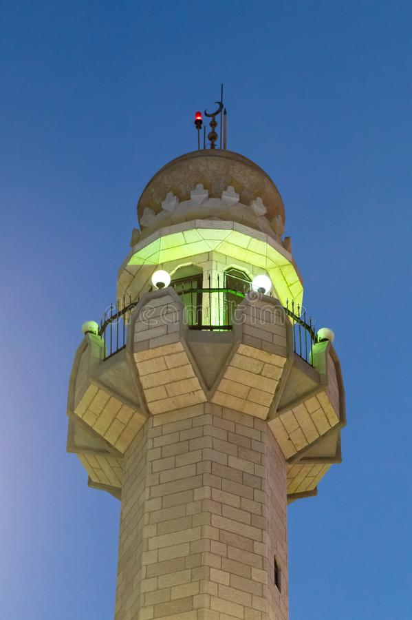 Evening view of upper part of the minaret of the Ahmadiyya Shaykh Mahmud mosque in Haifa city in Israel. Haifa, Israel, July 11, 2019 : Evening view of upper royalty free stock image