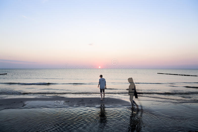 Evening walk at the beach royalty free stock photography