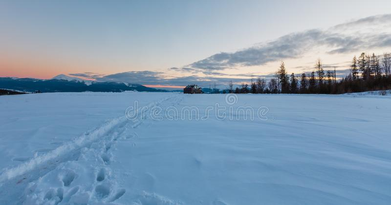 Evening winter mountain ridge view thru car windshield royalty free stock image