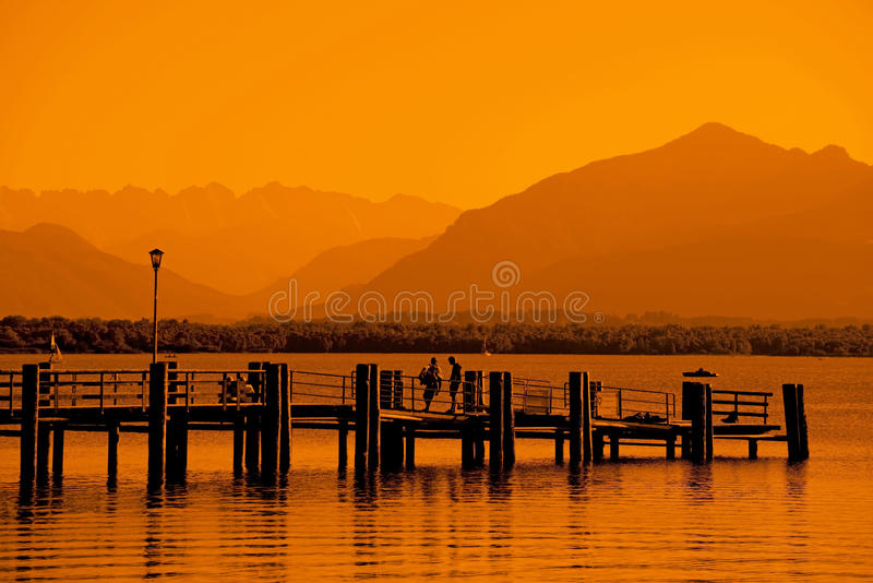 Eveningmood. At Chiemsee with red sunlight royalty free stock images