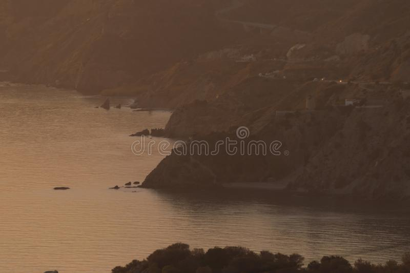 Evenings watching the sea and mountain with golden light. Oranges flowers royalty free stock photography