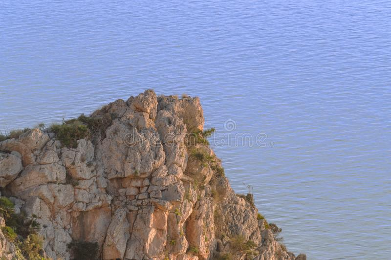Evenings watching the sea and mountain with golden light. Oranges flowers royalty free stock image