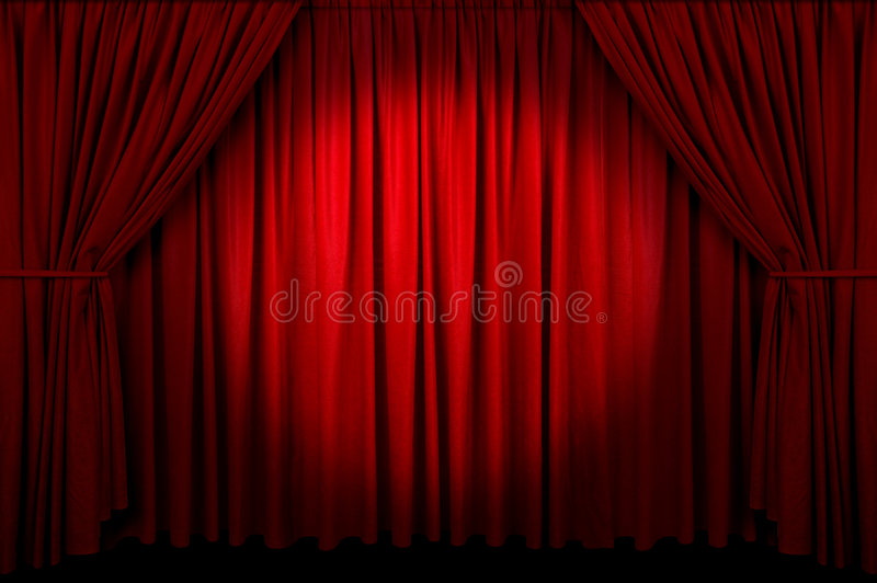Event Curtain. Large red curtain with spot light and fading into dark