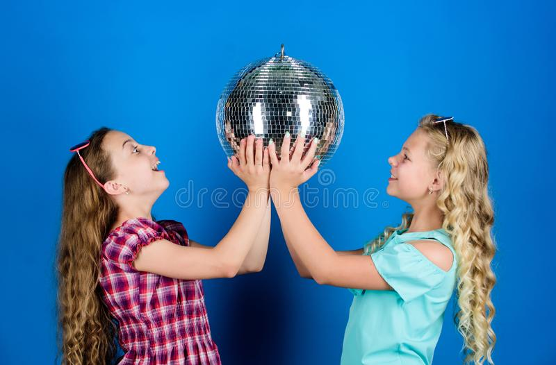 Event manager. holiday celebration. dancing and having fun. small girl spend time together. friendship and sisterhood. Concept. small girls with disco ball royalty free stock photography