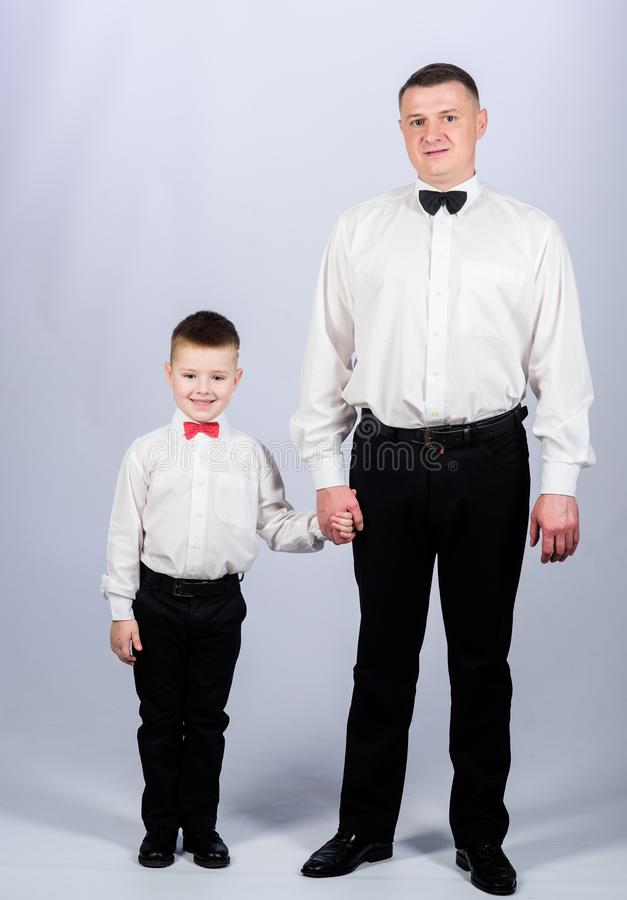 Event manager. male fashion. parenting. fathers day. small boy with dad businessman. family day. father and son in. Formal suit. happy child with father royalty free stock photography
