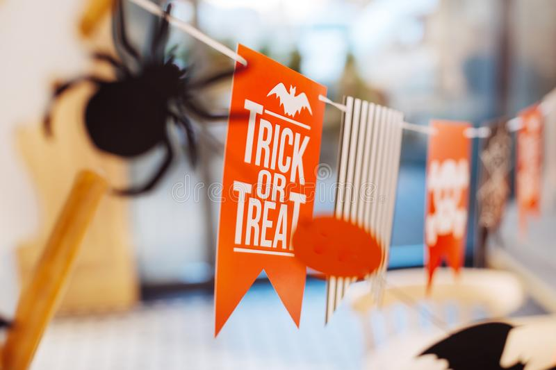 Event managers presenting their Halloween decorations with trick or treat sign stock photos