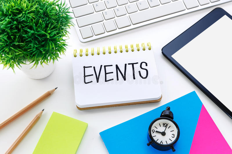 Event planning on working desk stock photo