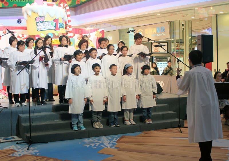 Evento caroling de la Nochebuena de Hong Kong en alameda del ámbito imagen de archivo