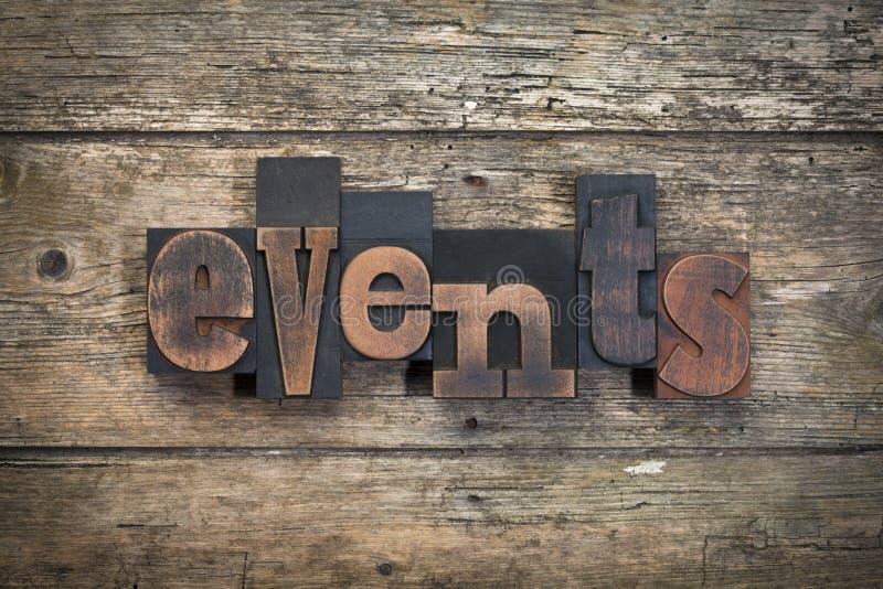 Eventos, palavra escrita com bloco de impressão da tipografia do vintage imagem de stock royalty free