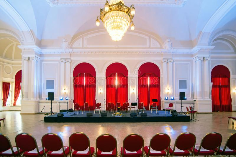 Events hall with stage prepared for classic music concert stock images