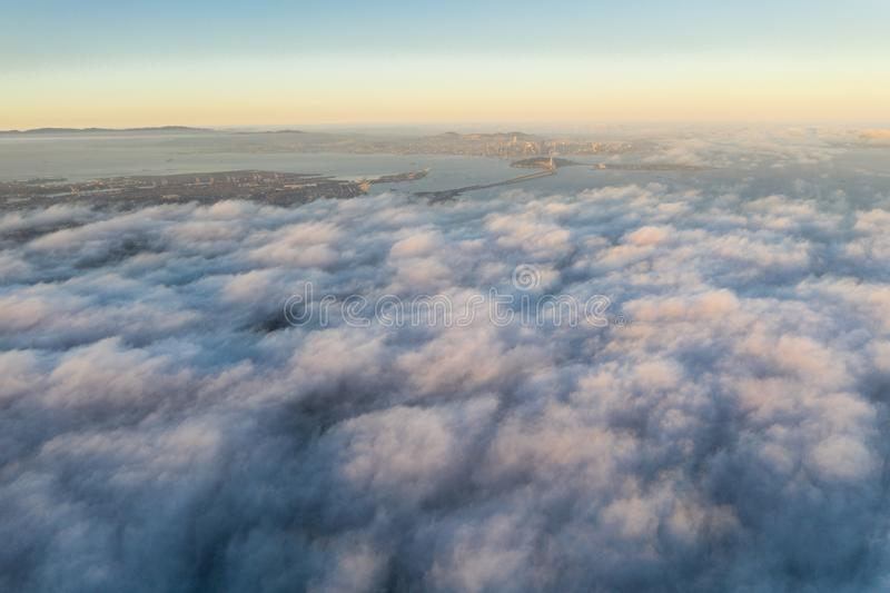 Aerial View of Marine Layer and San Francisco Bay Area. The ever-present offshore marine layer in California is propelled inland in the San Francisco Bay area by royalty free stock photo