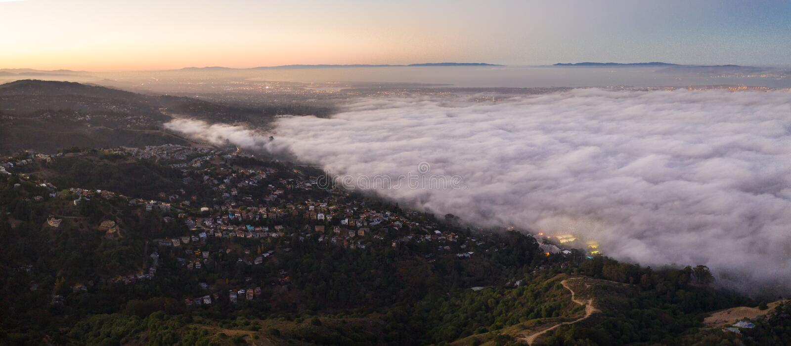 Aerial View of Marine Layer Flowing Over San Francisco Bay Area. The ever-present offshore marine layer in California is propelled inland in the San Francisco royalty free stock photo