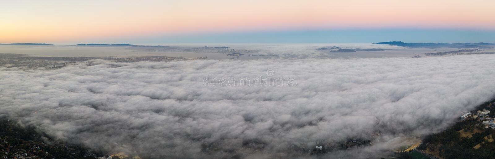 Aerial of Marine Layer Drifting Over San Francisco Bay Area. The ever-present offshore marine layer in California is propelled inland in the San Francisco Bay stock images