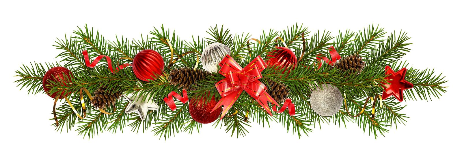 Evergreen twigs of Christmas tree and decorations in a festive royalty free stock photography