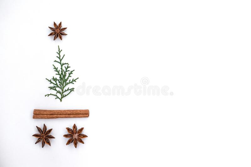 Evergreens with several spices christmas tree shape. Evergreen with anise and cinnamon spices christmas tree shape. Flat lay. Copy space stock photography