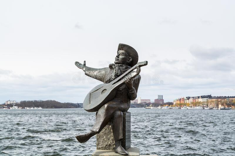 Evert Taube Statue Sweden`s much-loved balladeer,  located on the water side of Riddarholmen in Stockholm, Sweden.  royalty free stock photography