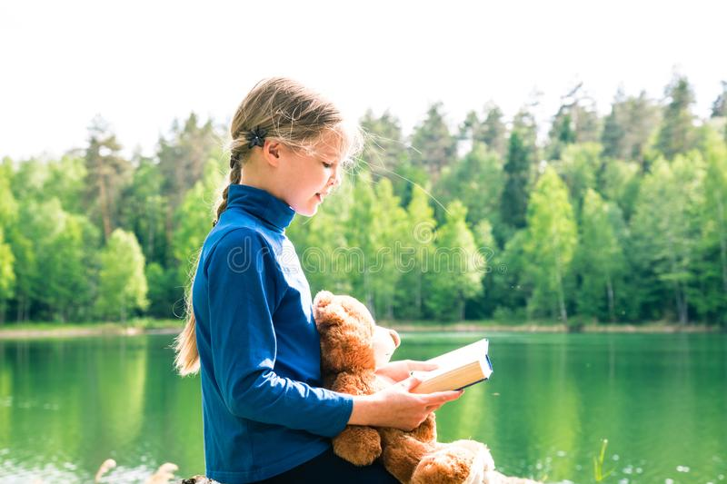 Every Child love Teddy Bear as their Best Friends hugging and holding together to go to Picnic and read book. Teddy Bear is a fluffy toy for little cute girl stock image