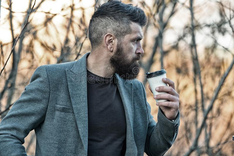Every morning begins with coffee. Hipster hold cup with hot drink on autumn morning. Man director drink morning coffee royalty free stock photography