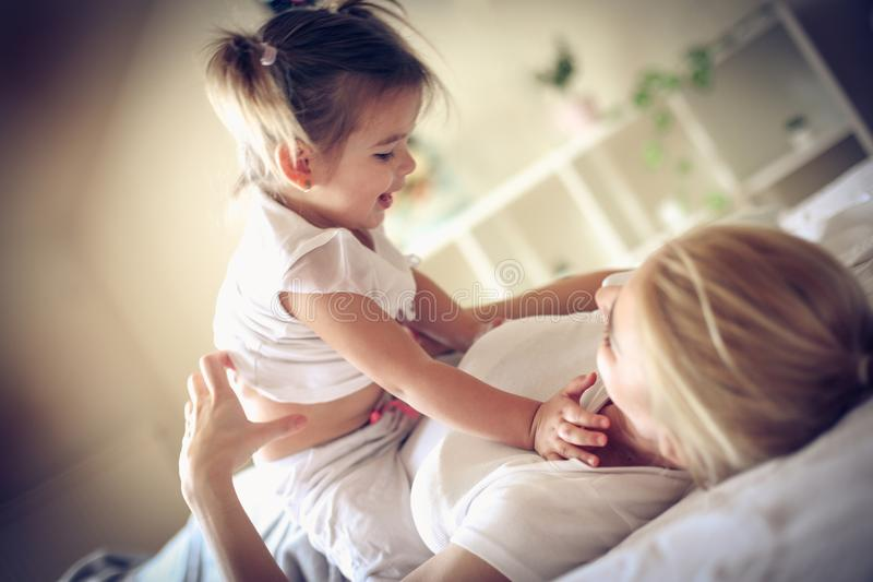 Every morning my mommy have playing with me. Little girl. royalty free stock image