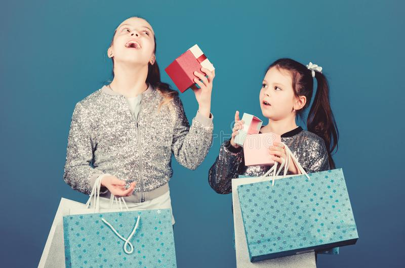 Every product delivered to you. Girls sisters friends with shopping bags blue background. Shopping and purchase. Black. Friday. Sale and discount. Shopping day royalty free stock image