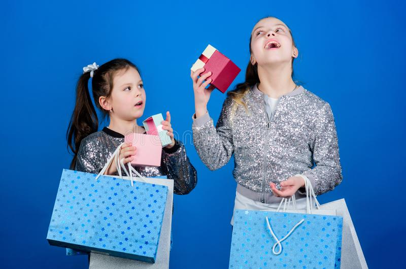 Every product delivered to you. Girls sisters friends with shopping bags blue background. Shopping and purchase. Black. Friday. Sale and discount. Shopping day royalty free stock images