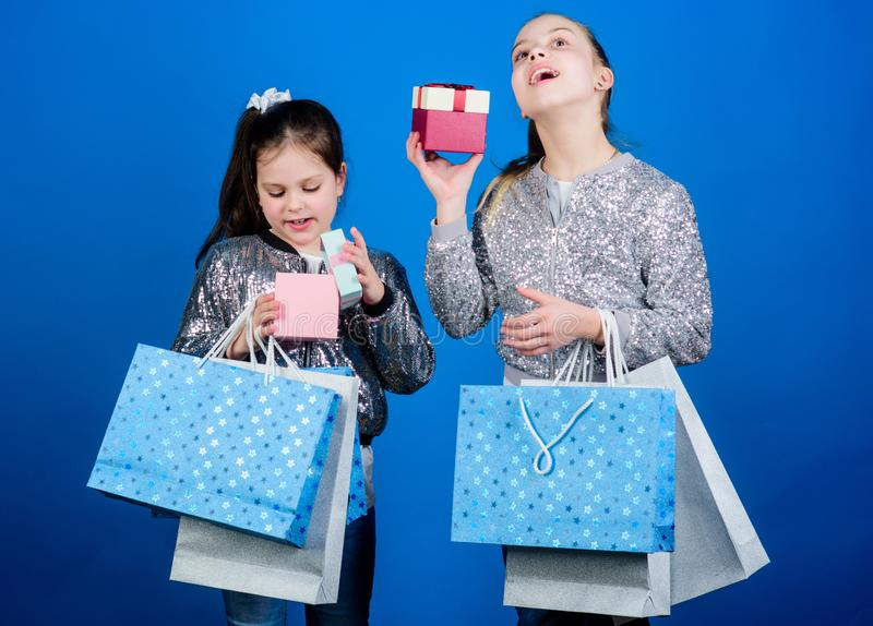 Every product delivered to you. Shopping and purchase. Black friday. Sale and discount. Shopping day. Children bunch. Packages. Kids fashion. Girls sisters stock photo
